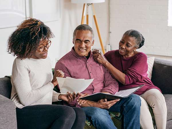 African American woman counsels elderly couple on how to create their will