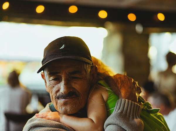 elderly refugee man reunites with his granddaughter in the U.S.
